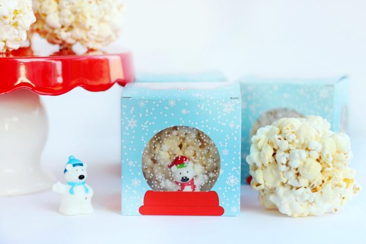 marshmallow popcorn balls inside snow globe boxes