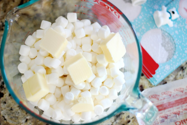 butter and marshmallows in bowl to be microwaved