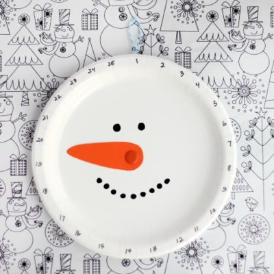 finished paper plate snowman on work space