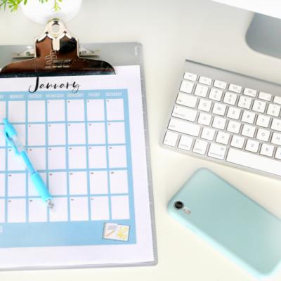 clip board with calendar page on white desk