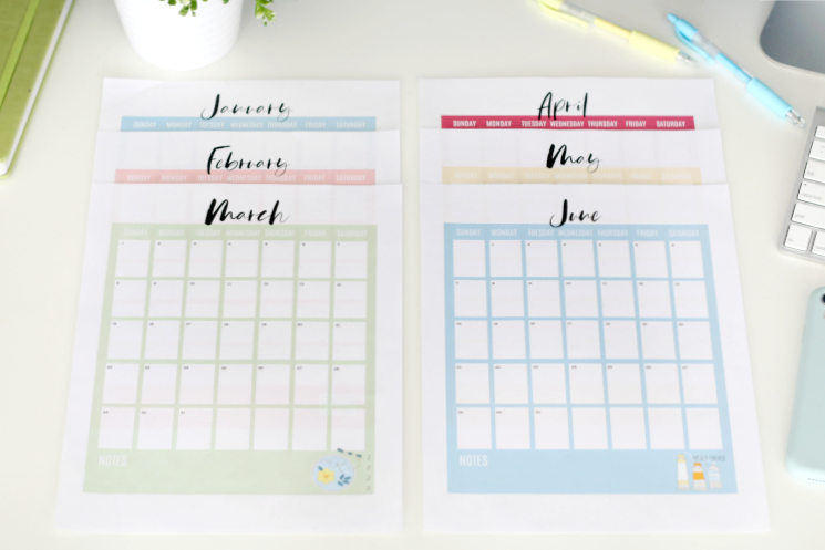 2020 printable calendar pages arranged on a table