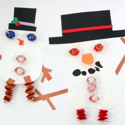 two finished snowman crafts on table
