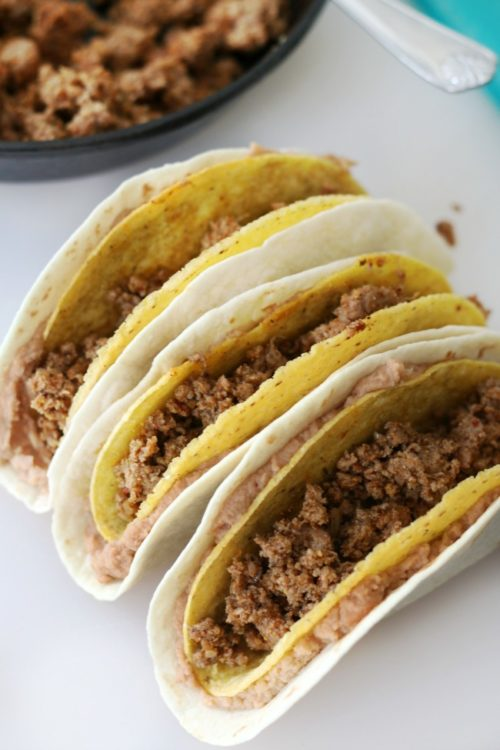 corn and flour tortilla layered with refried beans and filled with meat.