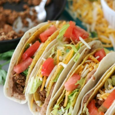 4 tacos standing up on plate