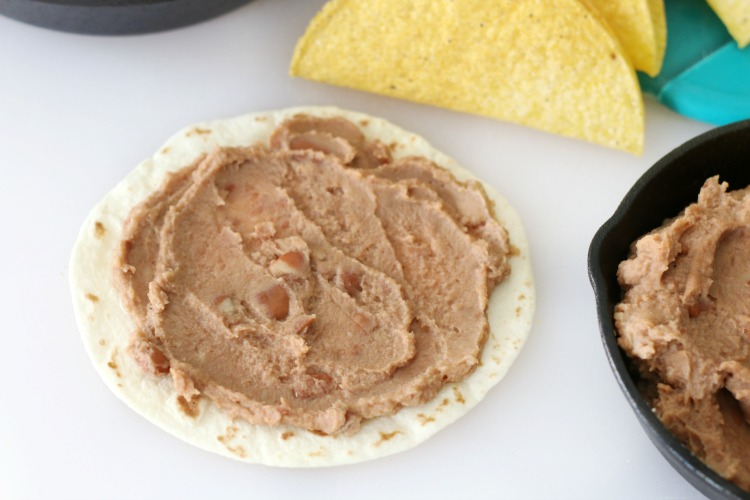 refried beans on tortilla