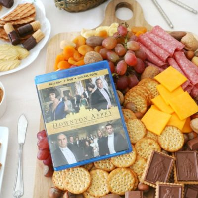 fruit and cheese board with DVD of downtown abbey