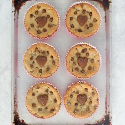 giant chocolate chip cookies on baking sheet