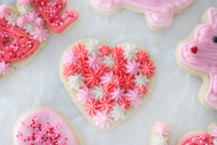 heart sugar cookie decorated with star frosting tip