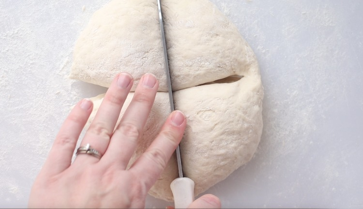 dividing dough into 4 sections