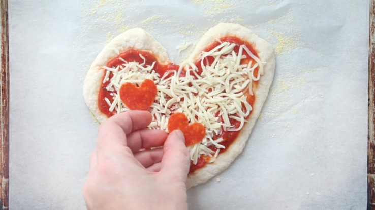 adding pepperoni to heart pizza