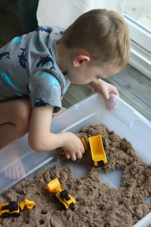 tote filled with kinetic sand