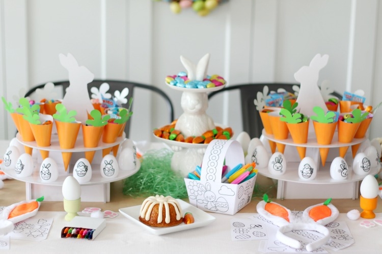 crafty easter tablescape with bundt cake on plate, diy paper easter baskets and diy easter eggs