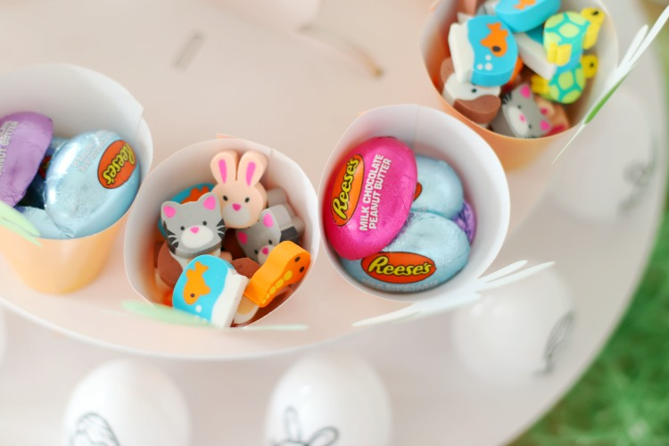 paper treat cups with chocolate candy and erasers