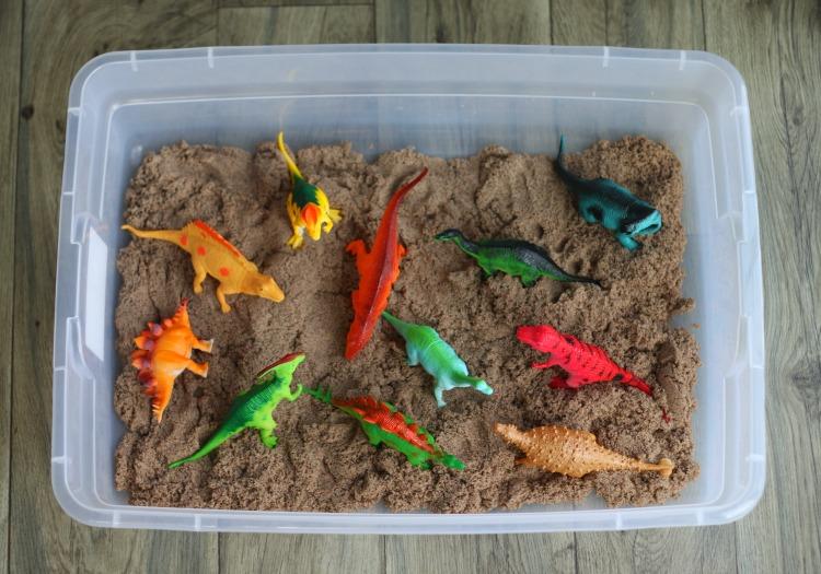 mini dinosaur toys in kinetic sand