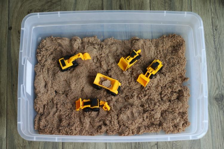 construction toys in sandbox