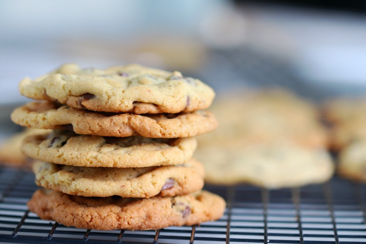 stack of chocolate chip cookies on cooling rack