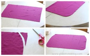 maroon fabric rectangle with rounded corners on table