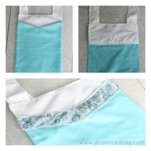 elsa apron bodice on table with silver trim