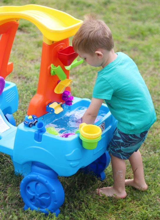 step2 car wash for kids with child playing in water