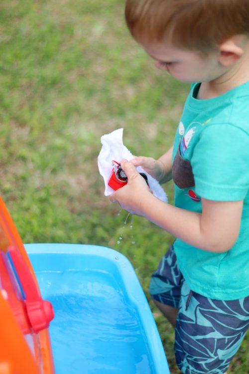 child washing toy truck