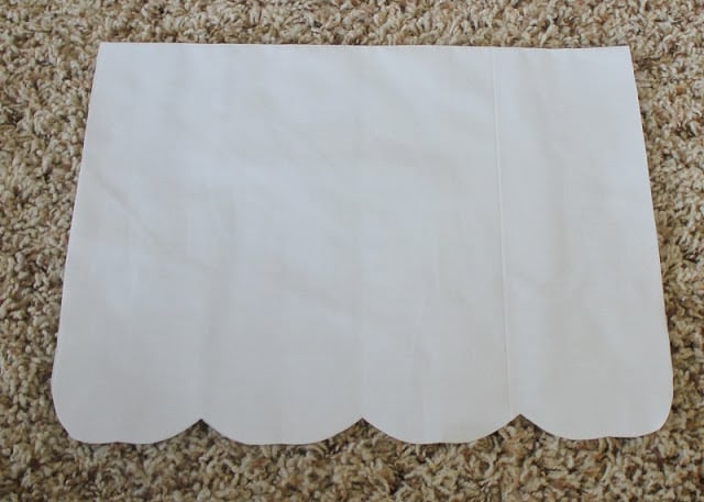 white fabric with scalloped edge