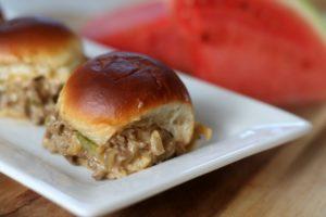 cheesesteak sloppy joe sliders on platter
