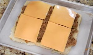 rolls with cheesesteak filling and cheese on top