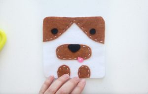 front of dog softie with felt eyes, nose and tongue