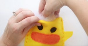 stuffing the duck softie with pillow stuffing