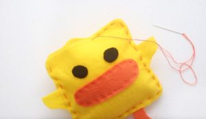 needle and thread stitching duck opening closed