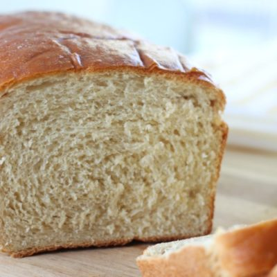 honey white bread with one slice cut from it