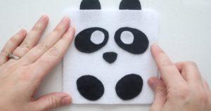 gluing on white felt circles for panda eyes