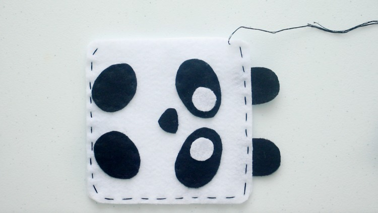 panda softie stitched with black thread ready to be stuffed
