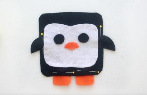 penguin softie pineed and ready to be stitched