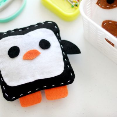 penguin softie on sewing table