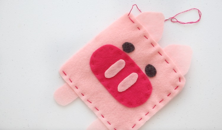 pig softie stitched with pink thread and ready to be stuffed