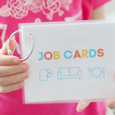 child holding job cards, laminated with ring
