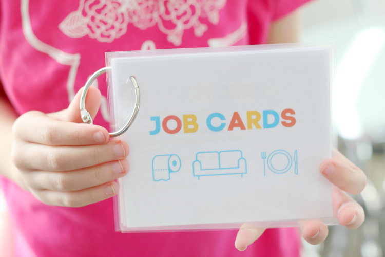 child holding job cards