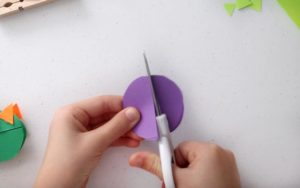 cutting construction paper into a circle