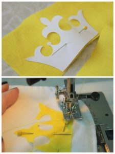 crown template pinned onto yellow fabric