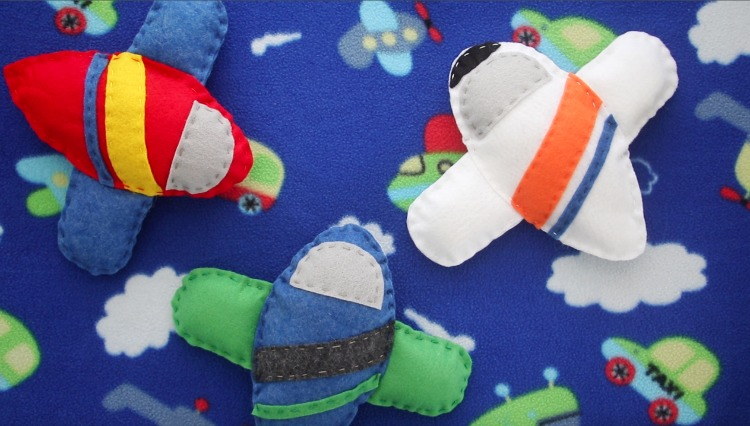 3 airplanes made with airplane sewing pattern
