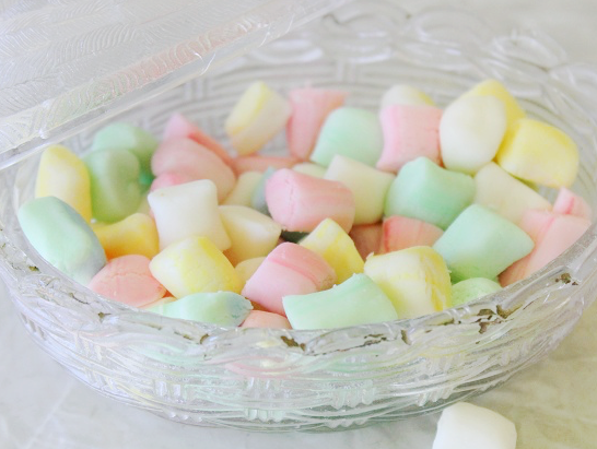 glass candy dish with colored butter mint candies