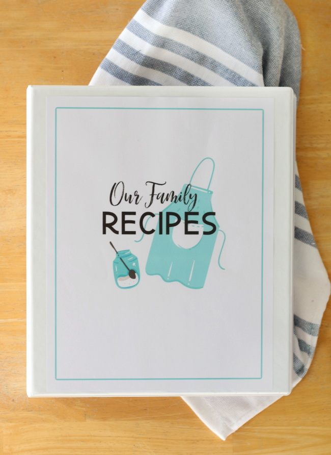 family recipe cookbook on table next to hand towel