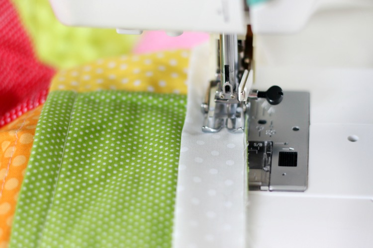 sewing machine stitching quilt binding
