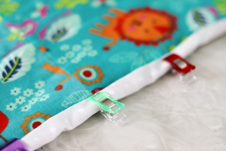 sewing clips clipped onto quilt binding