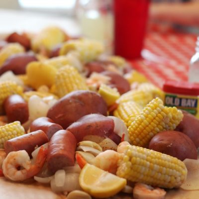low country boil spread across table with brown paper