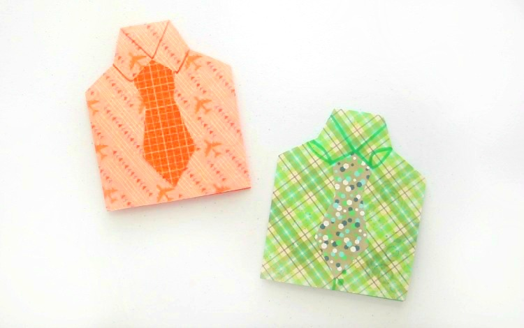 two finished shirt cards on table