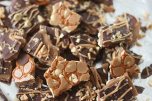 broken pieces of take 5 toffee on foil lined baking sheet