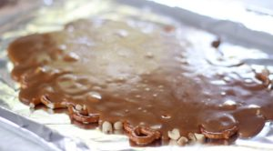 hot toffee poured over pretzels and peanuts