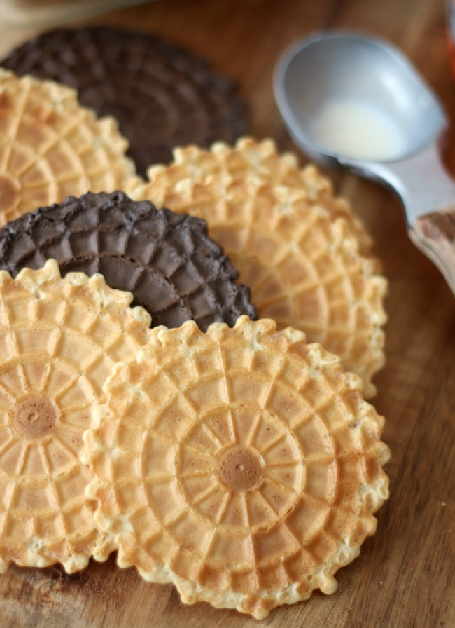 pizzelle cookies on wood cutting board